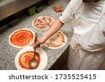The Pizza Maker Prepares A...