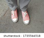 Women's Feet In Pink Sneakers...