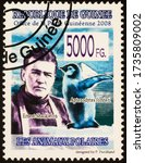Small photo of Moscow, Russia - May 20, 2020: stamp printed in Guinea shows portrait of Ernest Shackleton (1874-1922), Irish Antarctic explorer, and penguin, circa 2008