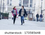 young couple smiling and having ... | Shutterstock . vector #173585648