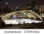 Stock photo toronto january people skating at nathan phillips square in toronto at night on january 173591462
