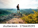 Man Hiking On Top Of A Rocky...