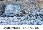 Small photo of Close up photo blast protection rubber mats at side of area with many stones from blasted rocks, new road construction site. Safety equipment to protect builders and equipment from blasting