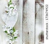 spring blossom and heart over... | Shutterstock . vector #173674922