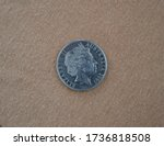 On the other side of the 2005 Australian 20 cent coin, homage is paid to Queen Elizabeth II
