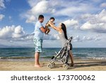 happy family at the beach... | Shutterstock . vector #173700062