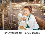 woman working in animal shelter | Shutterstock . vector #173710388