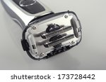 Small photo of Closeup Image of the Inner Blades Knifes of the Washable Electric Shaver On Reflecting Panel