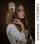 Small photo of Art photo of a languid elven girl with a barn owl on her shoulder