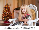 Cute Little Girl Sitting On A...