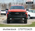 Small photo of Montreal, Canada - May 2, 2020: Red Chevy Z71 Silverado car. Chevrolet colloquially referred to as Chevy and formally the Chevrolet Division of General Motors American car manufaturing Company