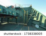 Small photo of view of ladder heading from main deck to forecastle deck on board of cargo ship