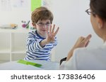 child in speech therapy | Shutterstock . vector #173836406