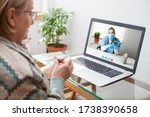 Small photo of Young female doctor consulting with elderly woman over video help line virtual medical appointment chat,GP prescribing medication to senior patient,telemedicine diagnosis,therapy and treatment concept