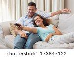 happy couple watching tv in... | Shutterstock . vector #173847122