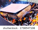A Thick Book On Fire. Burning...