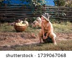 A Boy In The Village Plays Wit...