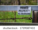 Sign On Wooden Fence Stating...