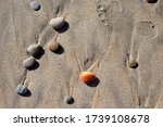 Colored Stones On Wet Sand....