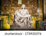 Small photo of Famous Pieta sculpture by Michelangelo in Saint Peter's Basilica, Rome.
