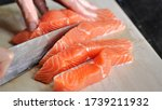 cutting  red salmon fish with a ... | Shutterstock . vector #1739211932