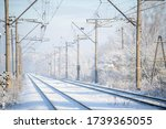 Train Tracks In Winter With...
