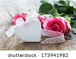 heart shape and roses on wooden background  - stock photo
