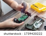 Small photo of Toronto, Canada - Mat, 23,2020: Close up of disassemble game controller repairing, cleaning or diagnostic.