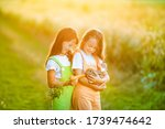 Two Cheerful Little Girls In...