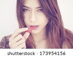 A portrait of a asian woman with heart candy  - stock photo