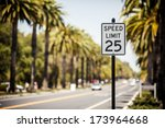 Speed Limit 25 Sign On The Roa...