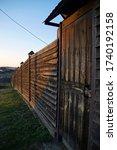 Dark Wooden Picket Fence With ...