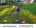 Disc golf basket with discs...