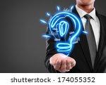 business man with idea light... | Shutterstock . vector #174055352