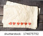 wooden heart on old paper | Shutterstock . vector #174075752