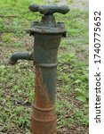 Rusty water spigot in the park. ...