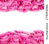 Stock photo abstract background made of rose blooms with white space for text 174093086