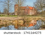 Small photo of Wealthy countryside manor or estate (Torups Slott) captured through bare trees conveys the concept of ancient earldom or viscountcy. Torup castle or castle shows a historical rural Nordic countryside