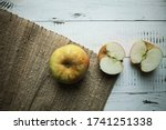 Two Red Yellow Apples Lie On A...