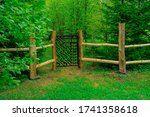 Wooden Fence With Cast Iron...