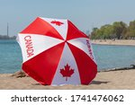 A Canadian Flag Umbrella On The ...