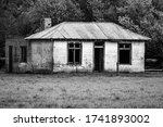 A Ruined Old Farm House Sits...