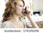 asthma treatment  woman | Shutterstock . vector #174190298
