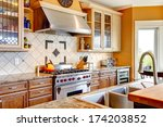Stock photo yellow tones kitchen with tile decorated back plash kitchen appliances 174203852