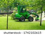 A Small Tractor Digs A Tree...
