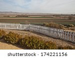Winter gardens and fields at San Juan Bautista Mission - stock photo