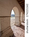 Adobe archway at San Juan Bautista Mission - stock photo
