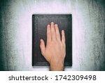 A Male Palm On A Book  An Oath...