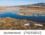 spring lake with old yellow... | Shutterstock . vector #1742328212