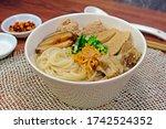 Small photo of Vietnamese rice noodle soup with pork spare ribs, Vietnamese sausage, mince, minced pork, Shiitake mushrooms (Kuey Jab Yuen).